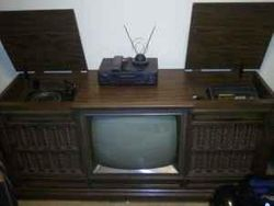 A late 1970's Curtis Mathes Cosole with TV, record player and 8-track player.