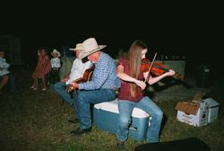 Johnny and daughter Fawn in a pasture camping out and making music