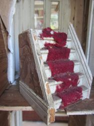 Old flaky red carpet on these stairs