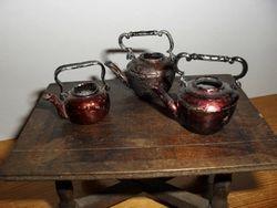 three similar kettles
