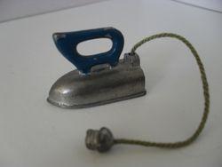 Soft metal iron with plug