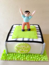 Trampoline cake wither personalised topper