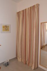 Single curtain for door in master bed to upper patio, includes fittings