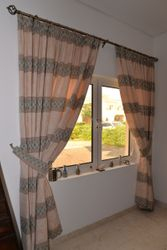 Full set of matching curtains and blinds plus fittings for lounge and dining room