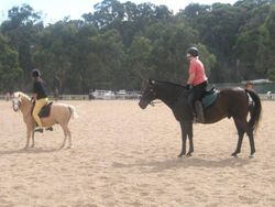 Ann & Lauren K standing up in the saddle