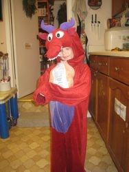 A Dragon Holding a Frozen Organic Chicken