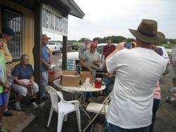 Ralph Orteaga accepting $50 Early Bird Prize.