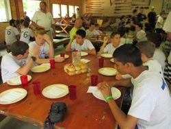 The troop occupied 4 tables in the dining hall