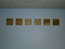 wood-carved emblems