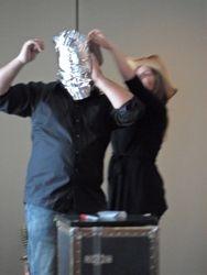 poker chip, duct tape. aluminum foil blindfold