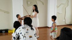 Children trying to play on my violin