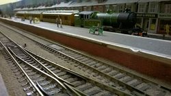 A Gresley V1 tank engine no 7684 pulls into the bay platform with a short local train.