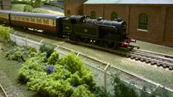 No 69543 heading for the station with 3 blood and custard Gresley coaches.