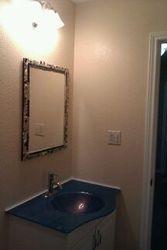 Bathroom w/ better view of custom vanity and sink