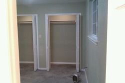 View from bathroom looking towards closets and back door right