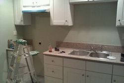 Kitchen cabinets installed with dual sink waiting on appliances!