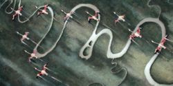 A flock of flamingo flying down South over a meandering river.