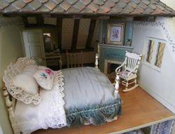 Bedroom with corner fireplace
