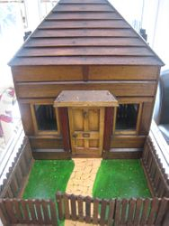 Unusual hand made wooden house