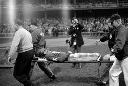 Frank Gifford gets hauled off the field