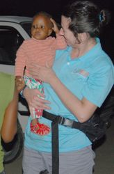 AidWEST Volunteer with Child