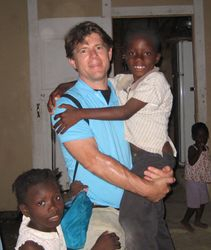 AidWEST Volunteer with Orphan.