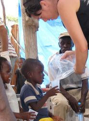 AidWEST Volunteer Treats Children