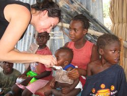 AidWEST Volunteer Treats Children.