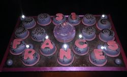 Mini cakes w/ big cupcake in center