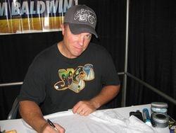 Adam Baldwin Signing a Brigade T-Shirt