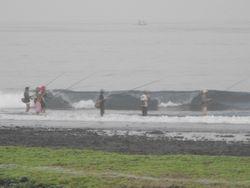 Locals fishing at Balangan Reef at low tide