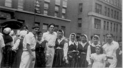 1948 NY dancers in  street with young girl