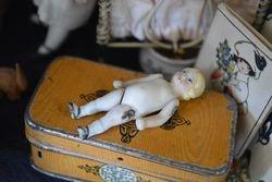 Tiny china doll