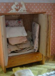 ... filled with tiny hand-made pillows and duvets.