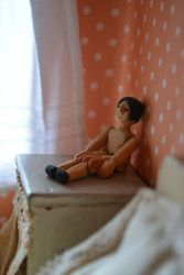 Tiny jointed wooden doll.