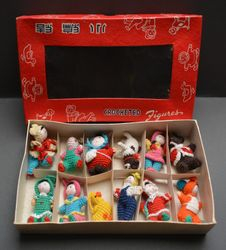 """Boxed set of crocheted figures marked """"Made in China!"""