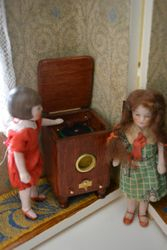 She perks up when the first record begins to play, and tired Nan listens delightedly to the delicate strains...