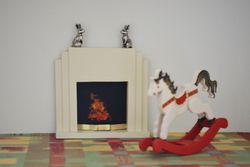 Fireplace with silver hares
