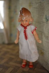 German painted bisque doll with classic 1940s quiff