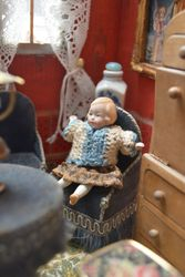 German all-bisque doll with antique clothes