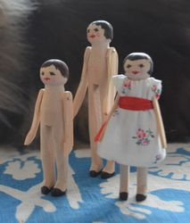Growing family of wooden dolls, close up