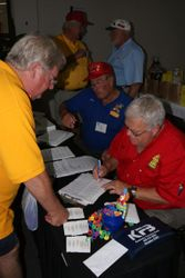 Carl Wellman, busy with registration