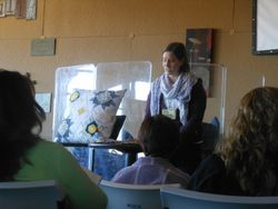 Megan giving a demonstration on the Scrappy Trip Around the World or Scrappy Trip Along Quilt