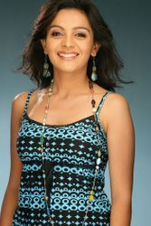 Ami Trivedi in blue - smiling