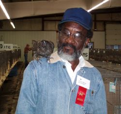 Larry Queen with one of his Blue American Game Bantam hens at a Rcky. Mtn. Feather Fanciers show in Brighton CO. 2008