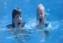 Taylor swimming with a friend
