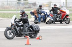 Dennis whips his Indian Scout through the course.