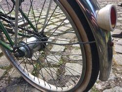 Hub and rear wheel