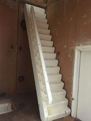 It has both sets of its original stairs with banister.