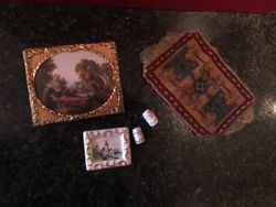 Pictures, balls of cotton and cigar rug.
